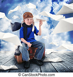Boy Pilot with Paper Airplanes Flying in Sky