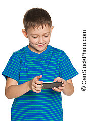 Boy plaing with smartphone