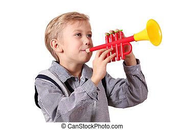 boy play trumpet