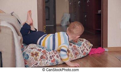 Boy play with pillows home interior
