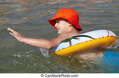 Boy played in the sea with rubber ring
