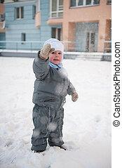 Boy playin in snow