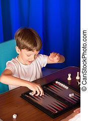 boy playing a board game