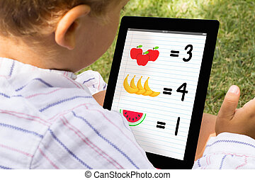 Boy playing and learning with tablet