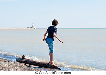 boy playing at a beach
