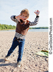 Boy playing at beach.