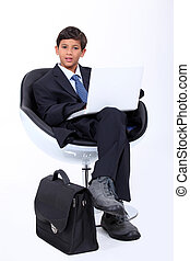 Boy playing at being a businessman