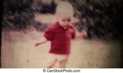 Boy playing ball. Vintage