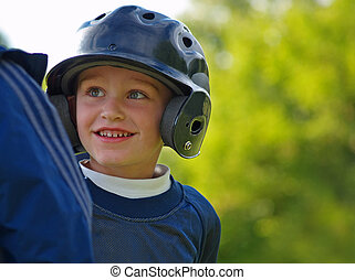 boy playing baseball - baseball player interacting with his...