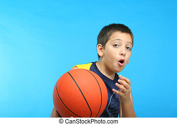 Boy playing basketball. Blue background