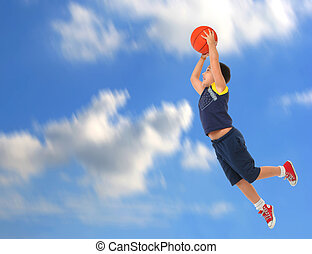 Boy playing basketball jumping and flying