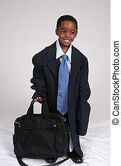 Boy playing businessman
