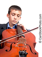 Boy playing Cello - Young boy student practicing playing ...