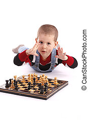 boy playing chess - Childre playing with chess in white...
