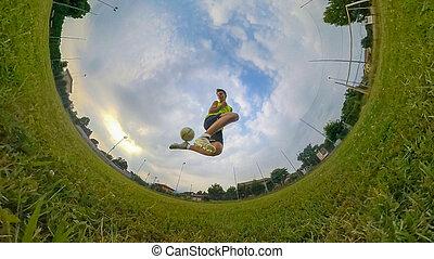 Boy playing football. - Caucasian boy playing football in...