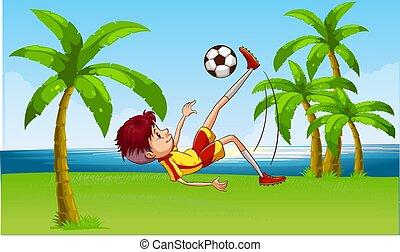 boy playing football on beach garden