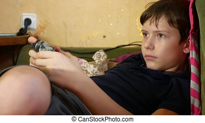 Boy playing game joystick online video game console - Boy...
