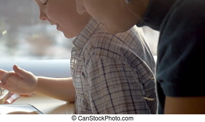 Boy Playing Games in Tablet PC