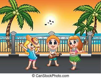 Boy playing guitar and hawaiian girl hula dancing at the seaside street