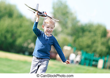 boy playing his toy plane