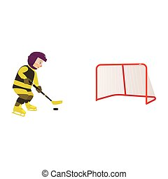 Boy playing hockey with puck and stick, side view