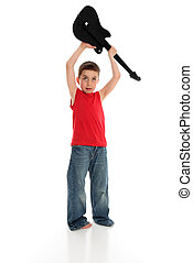 Boy playing holding guitar over head
