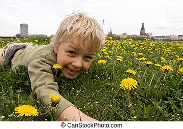 Boy playing in meadow
