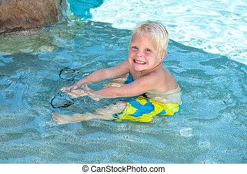 Boy playing in pool