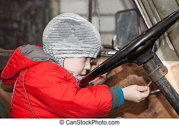 Boy playing in the car