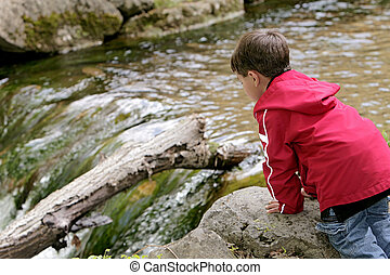 boy playing in the river