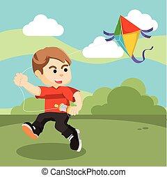 boy playing kite in field