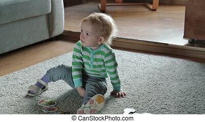 Boy playing on a light carpet
