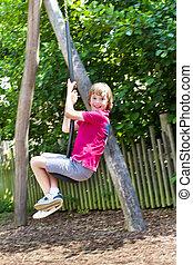 Boy playing on a swing