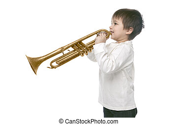 Boy playing on a trumpet