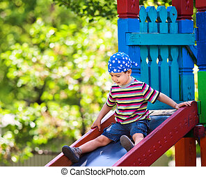 boy  playing on slide