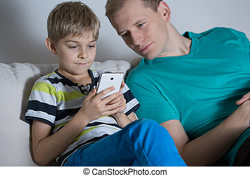 Boy playing on smarphone