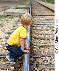 Boy playing on track