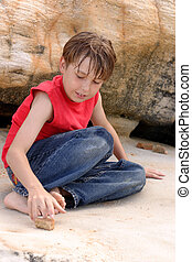 Boy playing outdoors