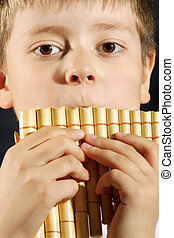 Boy playing panflute