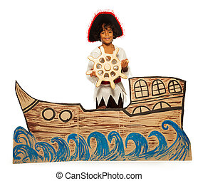 Boy playing pirate no cardboard ship steering