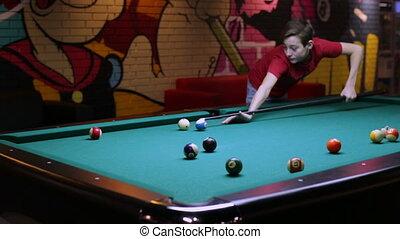 Boy playing pool billiard