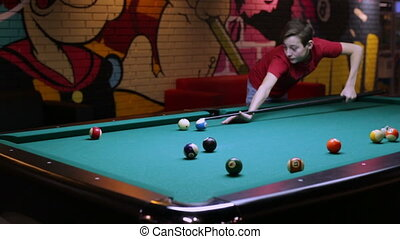 Boy playing pool billiard