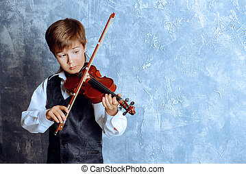 boy playing violin - Freckled nine year old boy playing the...