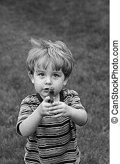 Boy playing with a gun