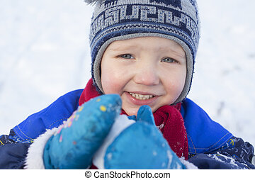 Boy playing with a snowball
