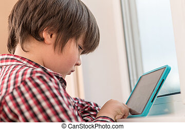 boy playing with a tablet