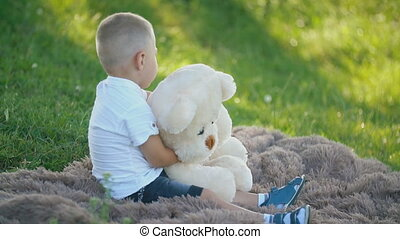 boy playing with a teddy bear