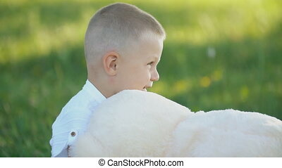 boy playing with a teddy bear