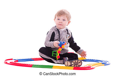 boy playing with a toy train - Toddler boy playing with a...