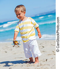 Boy playing with airplane